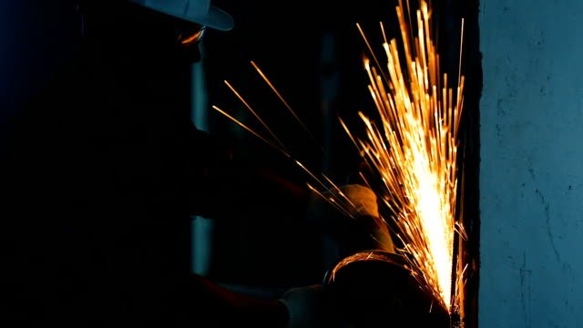 Industrial worker cutting metal with many sparks. Industrial worker cutting metal with many sparks. metal worker stock videos & royalty-free footage