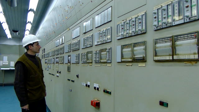 Industrial worker in a control room video