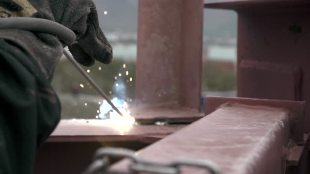 industrial worker welding at the construction site - ape operaia video stock e b–roll