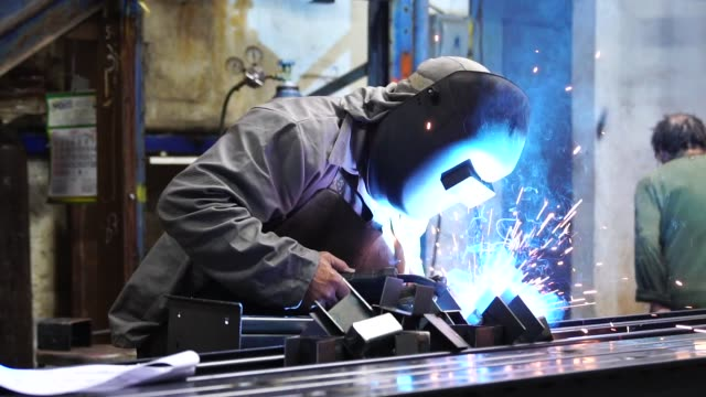 Industrial Worker welding steel Business and Industry construction equipment stock videos & royalty-free footage