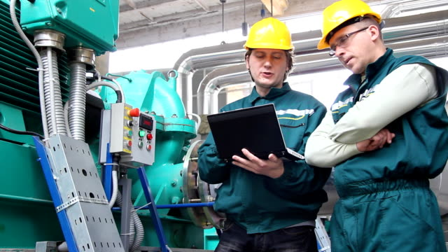 Industrial workers, teamwork video