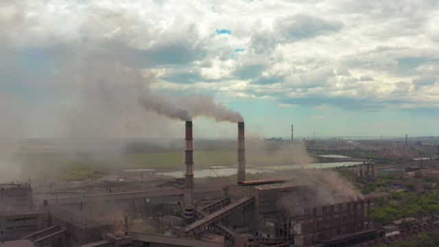industry pipes pollute the atmosphere with smoke, ecology pollution, smoke stacks - centrale elettrica video stock e b–roll