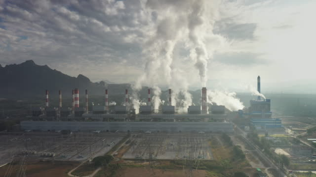 Industry Power plant pipes pollute the atmosphere with smoke