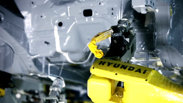 Industry robots,Assembling cars Assembling cars robot arm stock videos & royalty-free footage