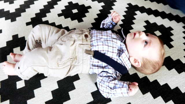 infant baby in pants and suspenders - solo neonati maschi video stock e b–roll