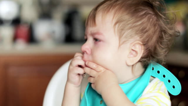 Infant boy wiping snot video