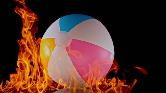SLO MO LD Inflatable beach ball in flames