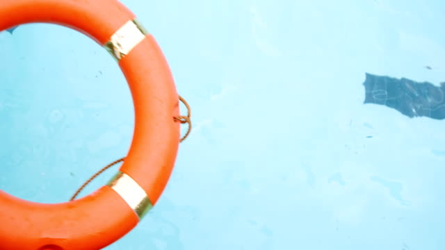 Inflatable ring floating in swimming pool video