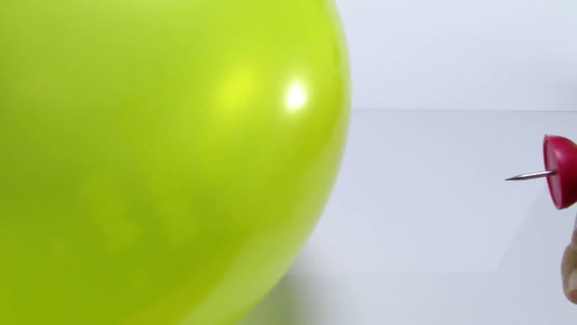 Inflated balloon sting with push pin and popping burst and sound video
