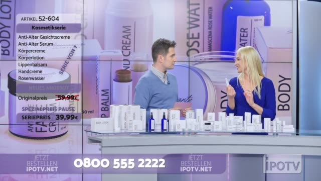 Infomercial montage in German: Woman presenting a cosmetic line on an infomercial show placing the product onto the male host's hand as they talk