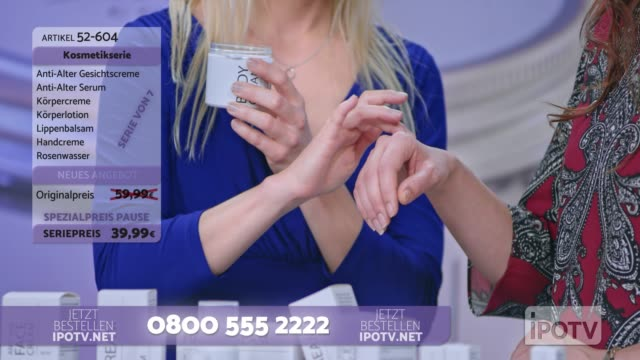 Infomercial montage in German: Woman presenting a cosmetic line on an infomercial show rubbing cream onto the hand of a female model while talking to the female host