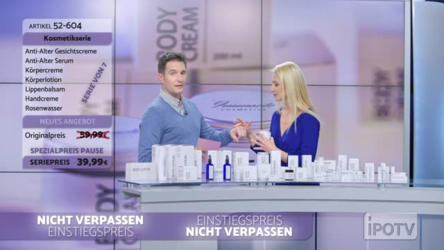 Infomercial montage in German: Woman presenting a cosmetic line on an infomercial show rubbing some cream onto the back of the male host's hand as they talk