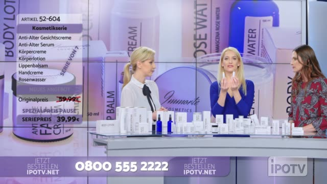 Infomercial montage in German: Woman presenting a lip salve from the cosmetic line on an infomercial show putting some on the female model's lips while talking to the female host