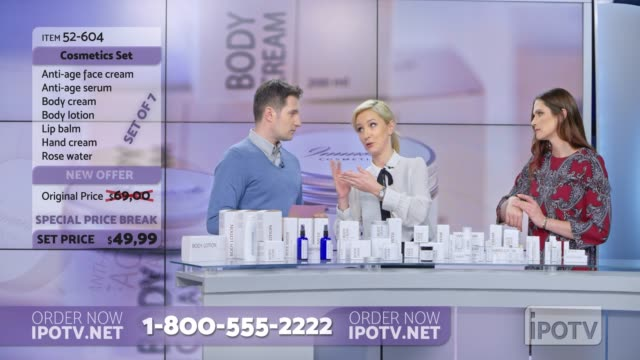 US infomercial montage: Woman presenting a cosmetic line on an infomercial show rubbing some cream on the female model while talking to the male host and explaining the product