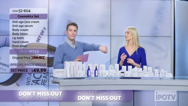 US infomercial montage: Woman presenting a cosmetic line on an infomercial show rubbing some cream onto the back of the male host's hand as they talk