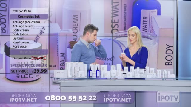 UK infomercial montage: Woman presenting a cosmetic line on an infomercial show rubbing some cream onto the back of the male host's hand as they talk