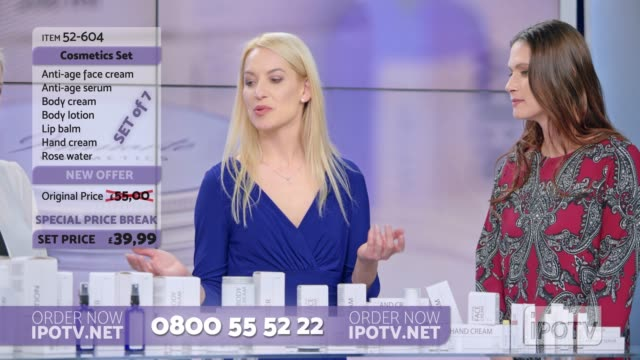 UK infomercial montage: Woman presenting a cosmetic line on an infomercial show with the help of a female host and a model Montage of clips edited to look like a British infomercial of a female presenter of a cosmetic line talking to the female host while spraying some perfume on the female model in the studio. Shot in Slovenia. television host stock videos & royalty-free footage