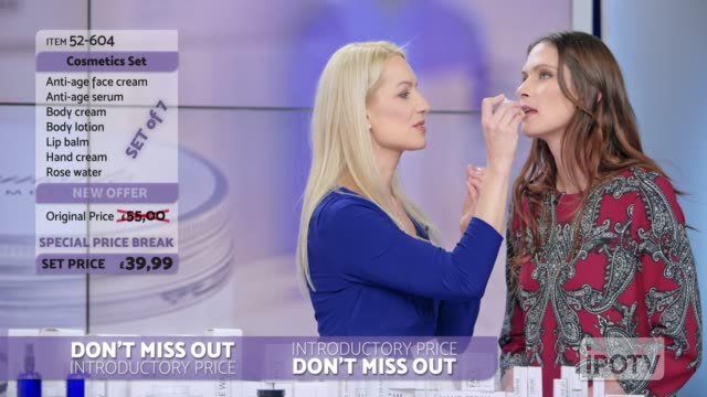 UK infomercial montage: Woman presenting a lip salve from the cosmetic line on an infomercial show putting some on the female model's lips while talking to the female host