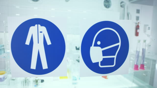 information sign in science laboratory. use protective workwear. - proibizione video stock e b–roll