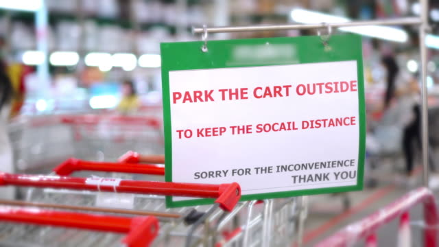 Information sign The cart outside for social distancing at the supermarket during Covid-19 pandemic.