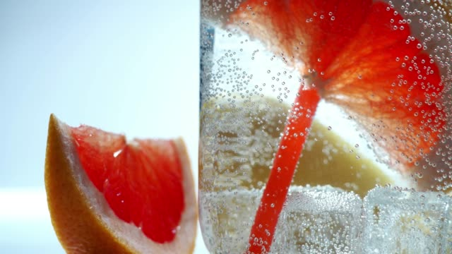 Infused water close-up Sparkling infused water with lemon and grapefruit slices in mason jar. Close-up carbonated stock videos & royalty-free footage