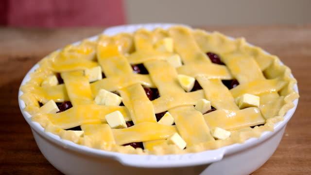 ingredients for baking cake stuffed with fresh cherry pie. female preparing cherry pie - bassino video stock e b–roll