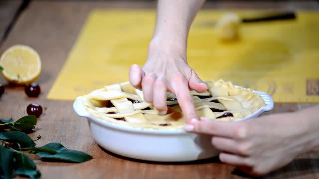 Ingredients for baking cake stuffed with fresh cherry pie. Female preparing cherry pie.