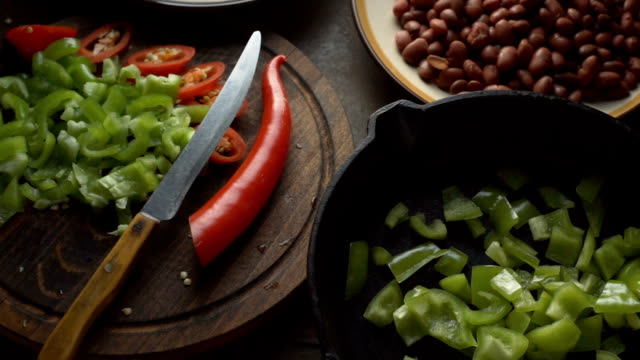 Ingredients for fajita and a knife on a cutting board. Video video