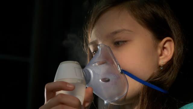 Inhalation Sick Girl with Inhaler in Living Room video
