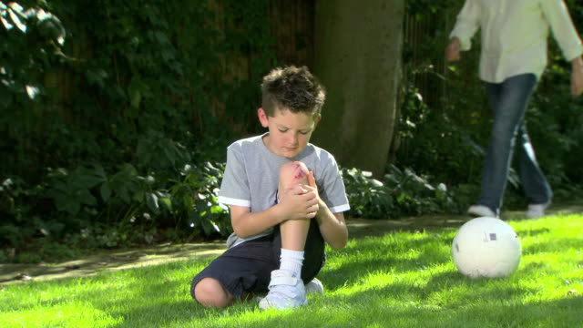 Injured boy comforted by father video