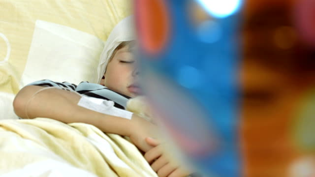 HD DOLLY: Injured Little Boy Sleeping In Bed video