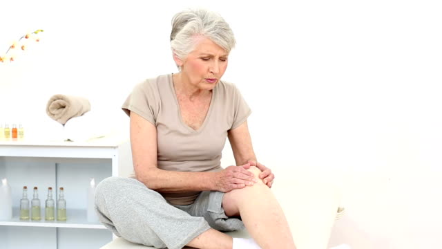 Injured patient rubbing her painful knee video