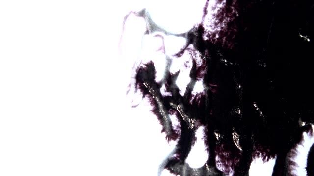 bläck sprider ut på papper - abstract silhouette art bildbanksvideor och videomaterial från bakom kulisserna