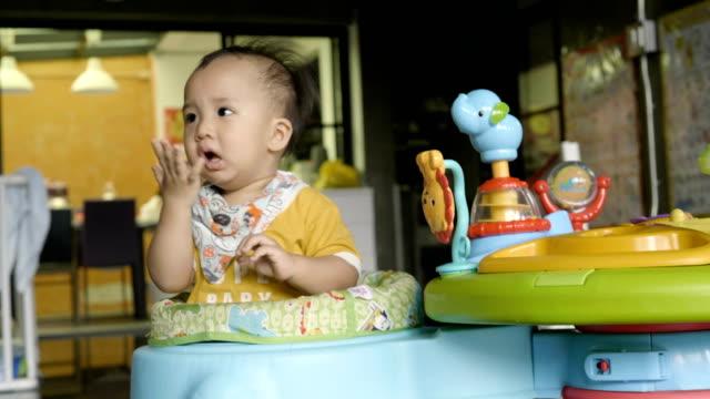 innocence baby boy playing at home - solo neonati maschi video stock e b–roll