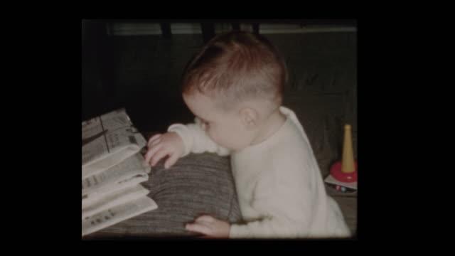 1960 inquisitive little boy searching around finds antique vacuum - hotel reception filmów i materiałów b-roll