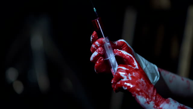 Insane person in latex gloves holding syringe with blood, crime, horror video