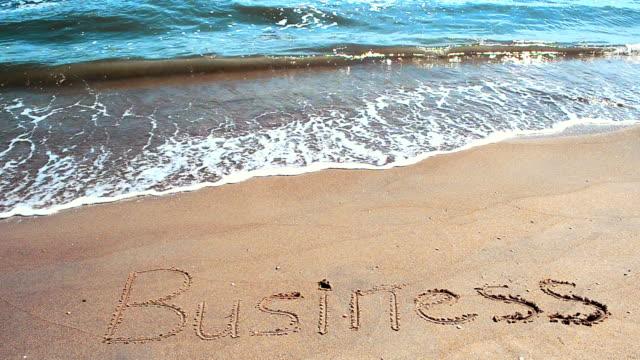 Inscription business on sand. video