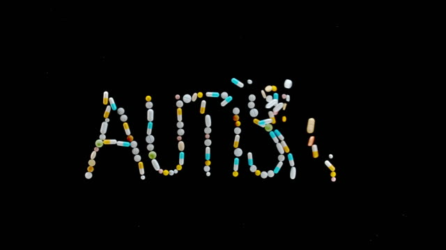 "SLO MO LD ""AUTISM"" inscription made out of colourful tablets, pills and capsules flying off the black surface Slow motion medium locked down shot of an inscription ""AUTISM"" made out of different tablets, pills and capsules blown off the black surface. Shot in Slovenia. autism stock videos & royalty-free footage"