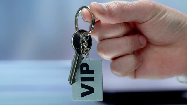 vip inscription on keychain in businessman hand, luxury resort for rich customer - key ring stock videos & royalty-free footage