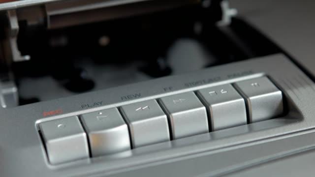 Insert cassette tape into the cassette tape player