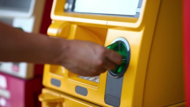 Inserting a credit card to ATM - video