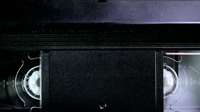 Inserting a VHS Tape into a VCR Player and showing how it works video