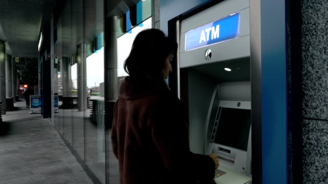 ATM inserting card entering password video