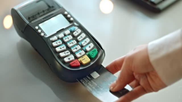 SLO MO inserting the credit card and typing the amount Slow motion close up shot of a person inserting the credit card into the terminal and typing the amount . credit card purchase stock videos & royalty-free footage