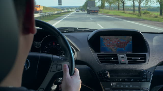 Inside a Car. A GPS Module is On Inside a car. A GPS module is on. Close-up shot global positioning system stock videos & royalty-free footage