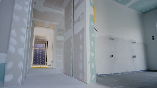 Inside a house after the drywall phase of construction Wide shot of the inside of a home after a finished drywall phase of construction. Shot in Slovenia. renovation stock videos & royalty-free footage