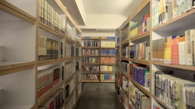 inside a library. - esame università video stock e b–roll