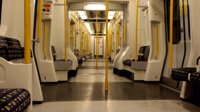 inside empty underground or tube carriage - cocchio video stock e b–roll