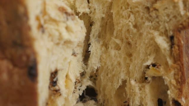 inside italian panettone cake 4k close-up video - panettone video stock e b–roll