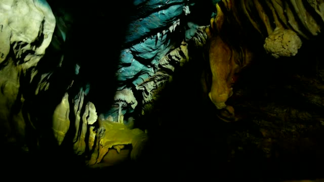 inside of a beautiful colourful cave. - кейвинг стоковые видео и кадры b-roll